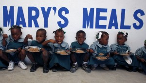 Mary's_Meals_comes_to_Cite_Soleil,_Haiti._PHOTO_BY_ANGELA_CATLIN